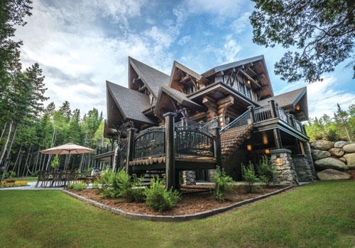 Maison en bois scandinave en bois rond etagres maisons for Balustres bois exterieur